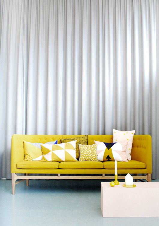 yellow mustard mod couch, boho bohemian decor design with curtain statement wall