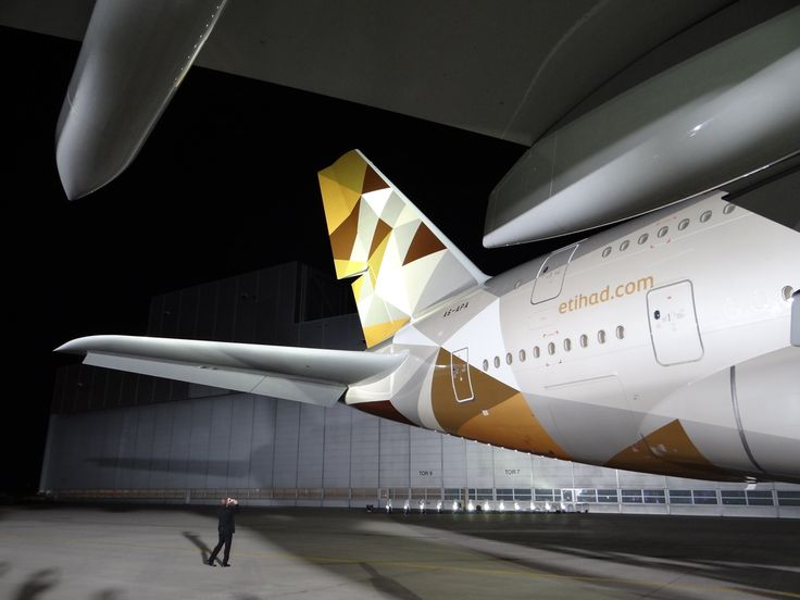 """A close-up of the A380 tail, possibly the most visible element in the airline's new livery, designed by Landor Associates and featuring a pattern called """"Facets of Abu Dhabi"""", inspired in the colours of the Emirati landscape"""