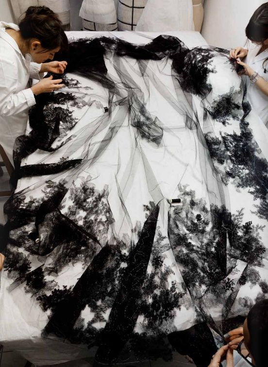 Haute Couture, the making of a dress - fashion atelier; dressmakers at work; fashion design behind the scenes