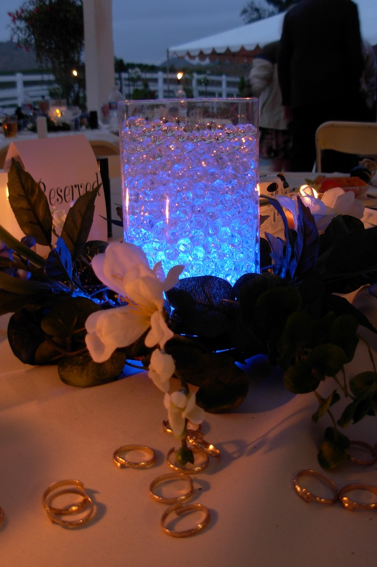 Wedding Centerpiece at night with water beads and blue floral lights