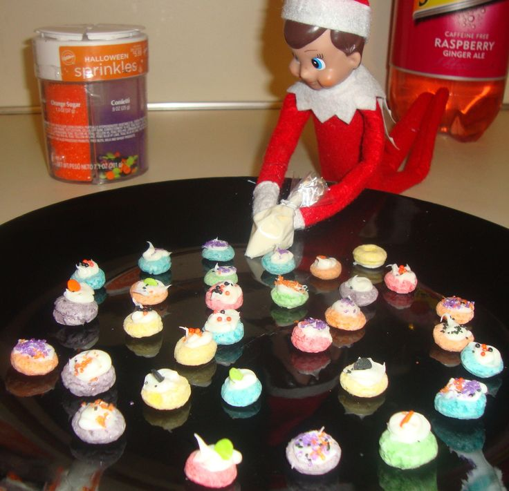 Elf cupcakes made with fruit loops and sprinkles!