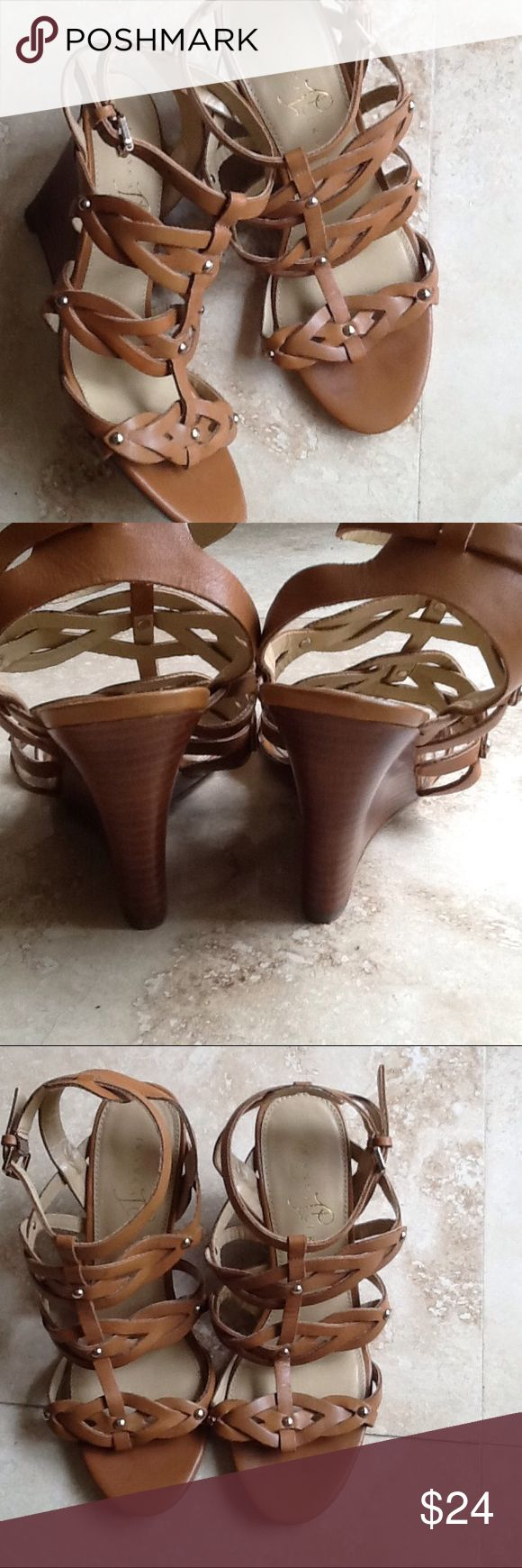 Ivanka Trump Gladiator Wedge Sandals Leather sandals. This brand runs big so they fit more like an 8. I will post them under both 71/2 and 8. I only have one pair for sale and price is firm. If you know this designer then you know it runs big. These are marked 7 1/2 on bottom  of shoe. In excellent used condition. Ivanka Trump Shoes Wedges