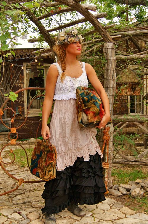 GASP! Carpet bags!!  Love everything else too, flower hat, cute boho dress, even the background is enchanted.