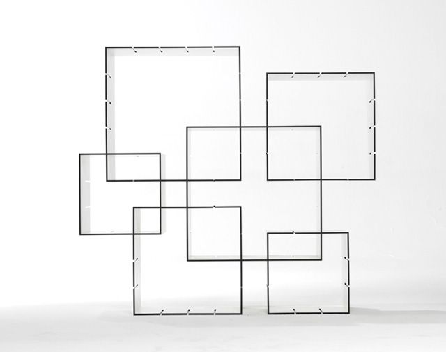 A Bookcase Made Of Interlocking Squares    You Can Customize The  Arrangement.