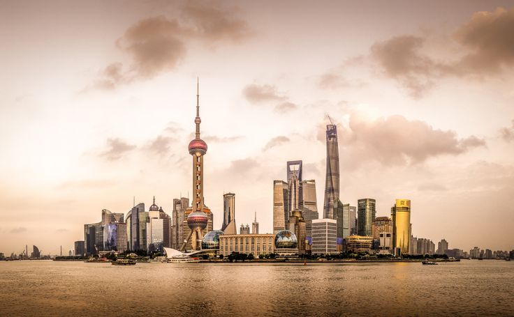 Golden Shanghai - I have to say this is probably my best shot so far. I took this picture on The Bund in Shanghai, facing Pudong district. As I only have a 35mm lens, I had to do a photo stitching to create this panorama.  Can't wait to do some more pics!