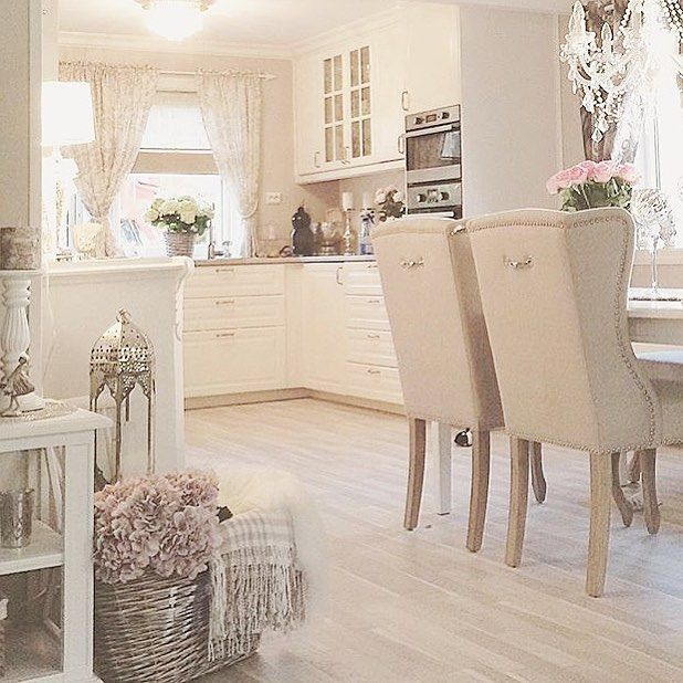 Decor: white kitchen and dining room for a young single woman. Lol too feminine for a family to me. Still love it.