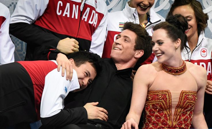 Canada at Sochi Games - Day 2 of Competition |- CTV News at Sochi 2014  ~~ Patrick Chan hugs Scott Moir as Tessa Virtue looks on after winning the Silver Medal for the Team Figure Skating Competition in Sochi.