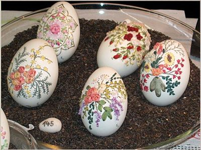 Embroidery on blown egg shells. Let's break it down-first you have to carefully empty and clean the egg. Then you plan your design. Next, carefully drill holes in the shells. Finally, painstakingly embroider through the one teeny hole at the bottom! Some also incorporate paint and other media. Amazing!
