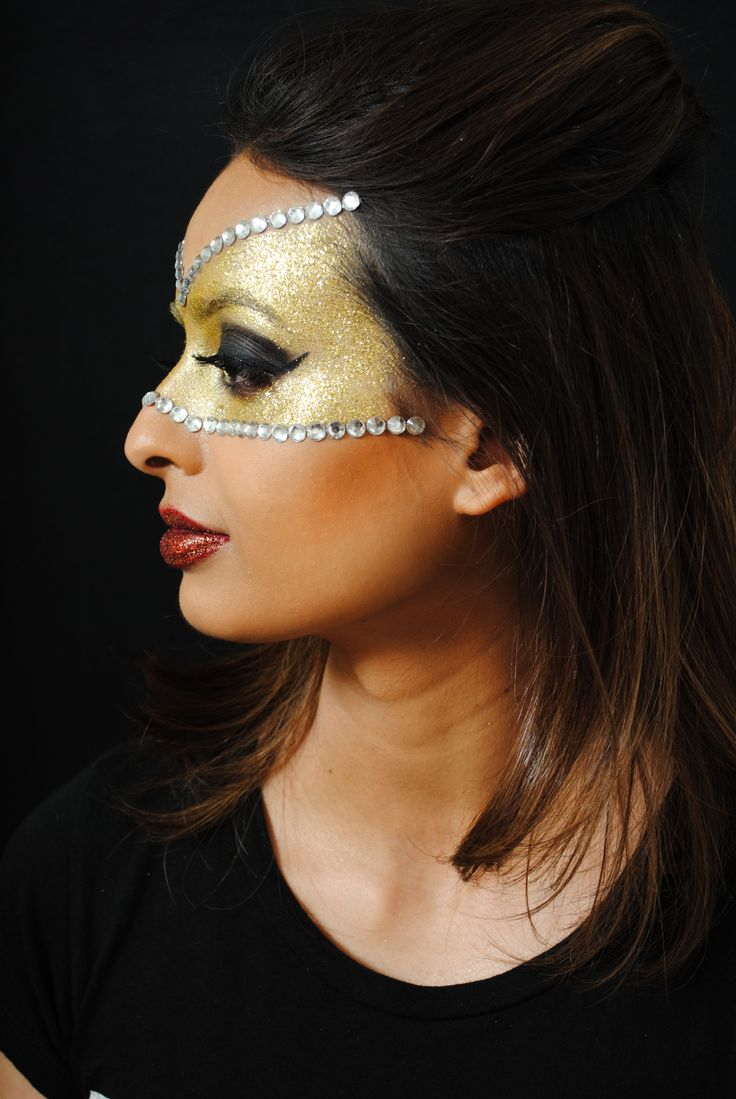 Creative mask masquerade makeup by one of our talented students.
