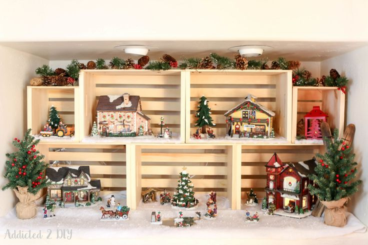 Create your own Christmas village display case or compose your own holiday story by using wooden crates as the backdrops for individual scenes.