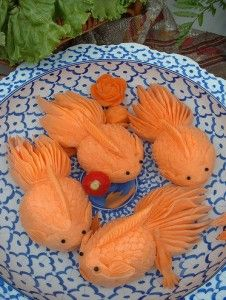Koi carved from either papaya or musk melon but super cute either way