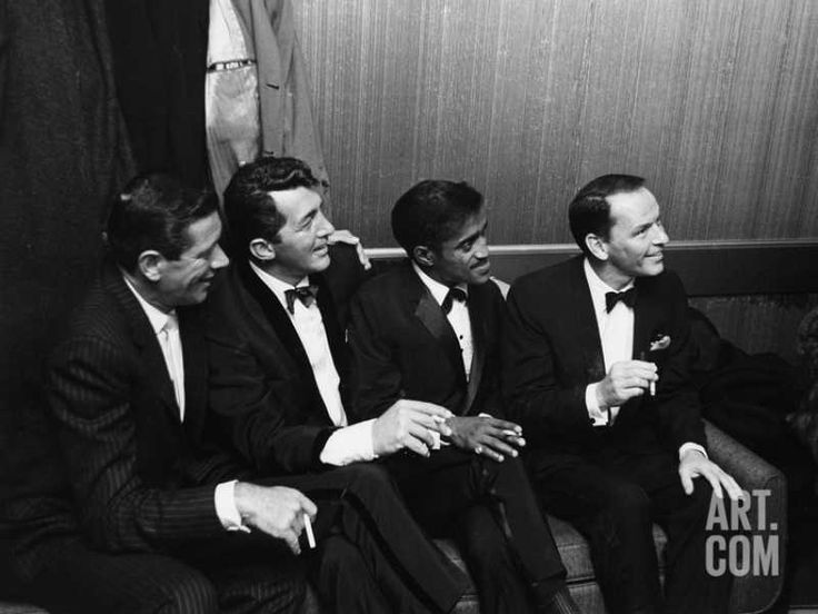 Jan Murray sits alongside Rat Pack members Dean Martin, Sammy Davis Jr & Frank Sinatra, as the group unwinds backstage at Carnegie Hall after entertaining at a benefit performance in honor of Dr. Martin Luther King Jr. January 27, 1961