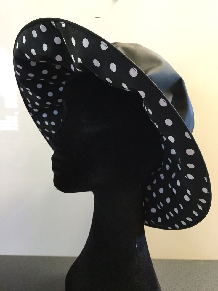 PRECIOUS CARGO TM Black Wet Weather Floppy hat with contrast white spot, fits any head size with adjustable tension, packs flat.