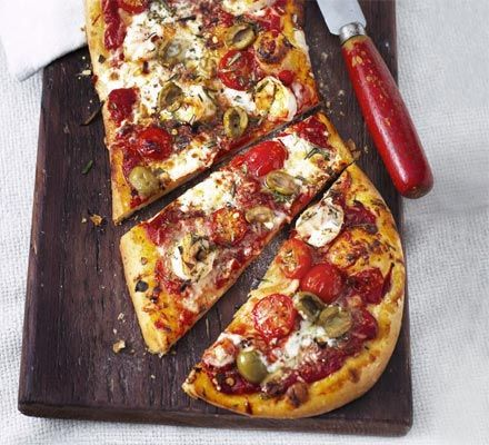 This low-calorie pizza is spread with homemade tomato sauce and topped with mascarpone, shellfish and olives #seafood