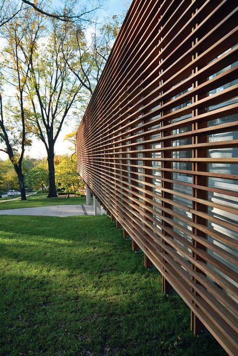 Modern facade with slatted Cumaru wood screen, Dan Rockhill, Lawrence, Kansas