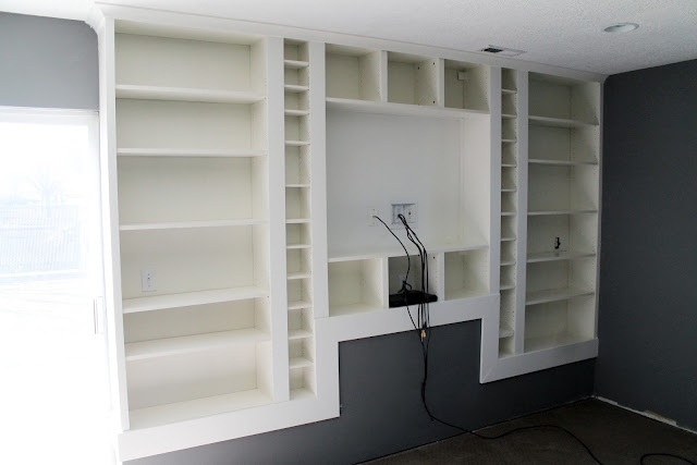 Built In IKEA Billy Bookcase - paint & add trim to create one, seamless, built-in look