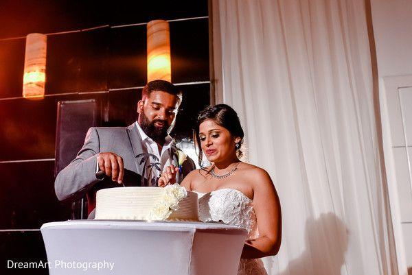 Bride & groom cutting the cake at wedding reception | Playacar Palace #destinationwedding