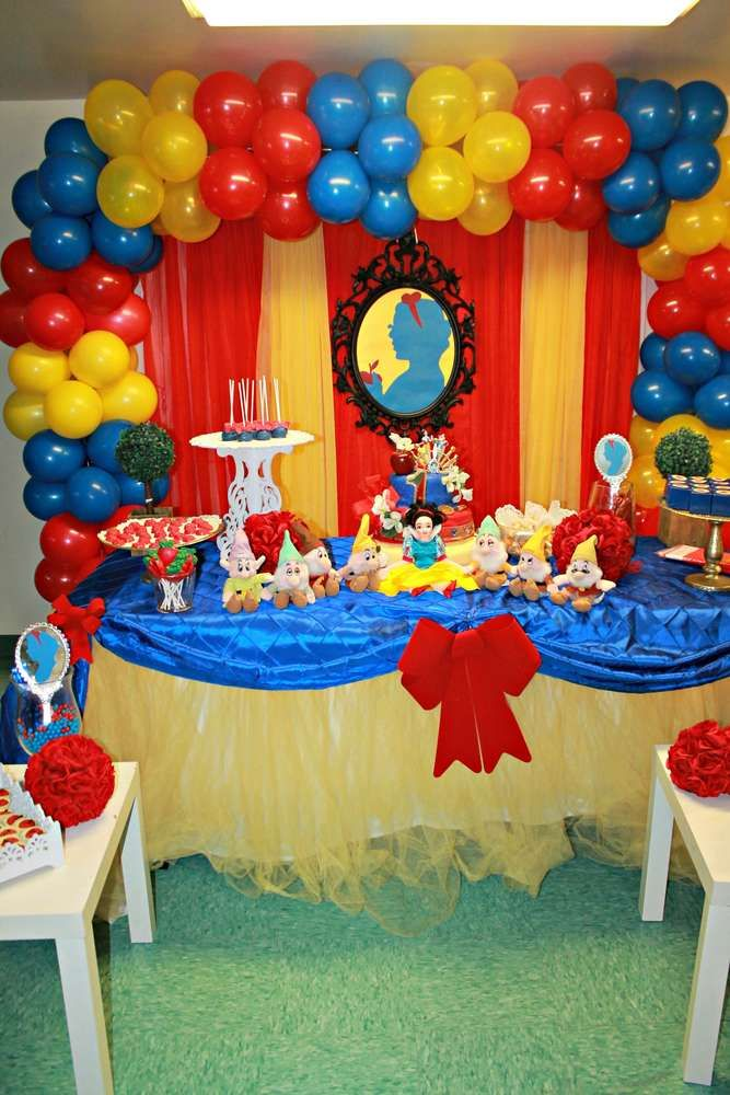 Red, blue and yellow dessert table and backdrop at a Snow White birthday party!  See more party planning ideas at CatchMyParty.com!