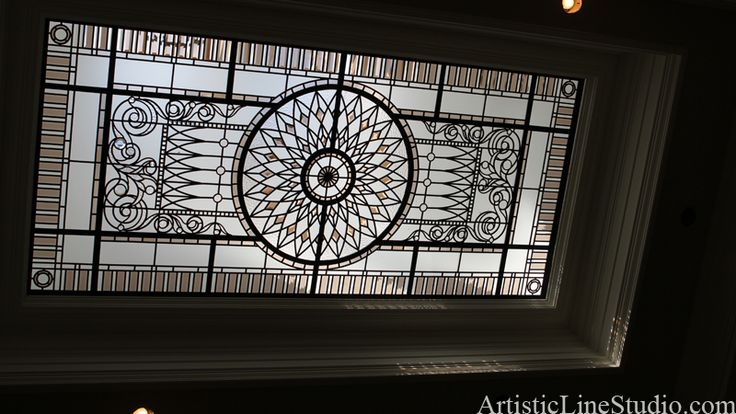 Stained and leaded glass flat skylight with colored bevelled glass in traditional style
