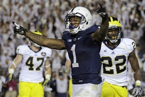 Penn State running back Bill Belton (1) celebrates after scoring against Michigan in the fourth overtime period of an NCAA college football game in State College, Pa., Saturday, Oct. 12, 2013. Penn State won 43-40. (AP Photo/Gene J. Puskar)