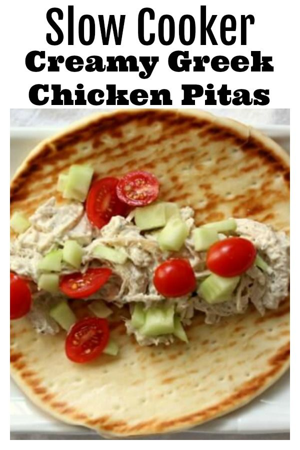 Slow Cooker Creamy Greek Chicken Pitas–a very easy recipe with just a handful of ingredients that tastes absolutely amazing! Cream cheese is stirred into shredded chicken with Greek seasonings and lemon juice and then served on pita bread and topped with tomatoes and cucumbers.  A simple family friendly meal that everyone will love. #slowcooker #crockpot #keto #chicken