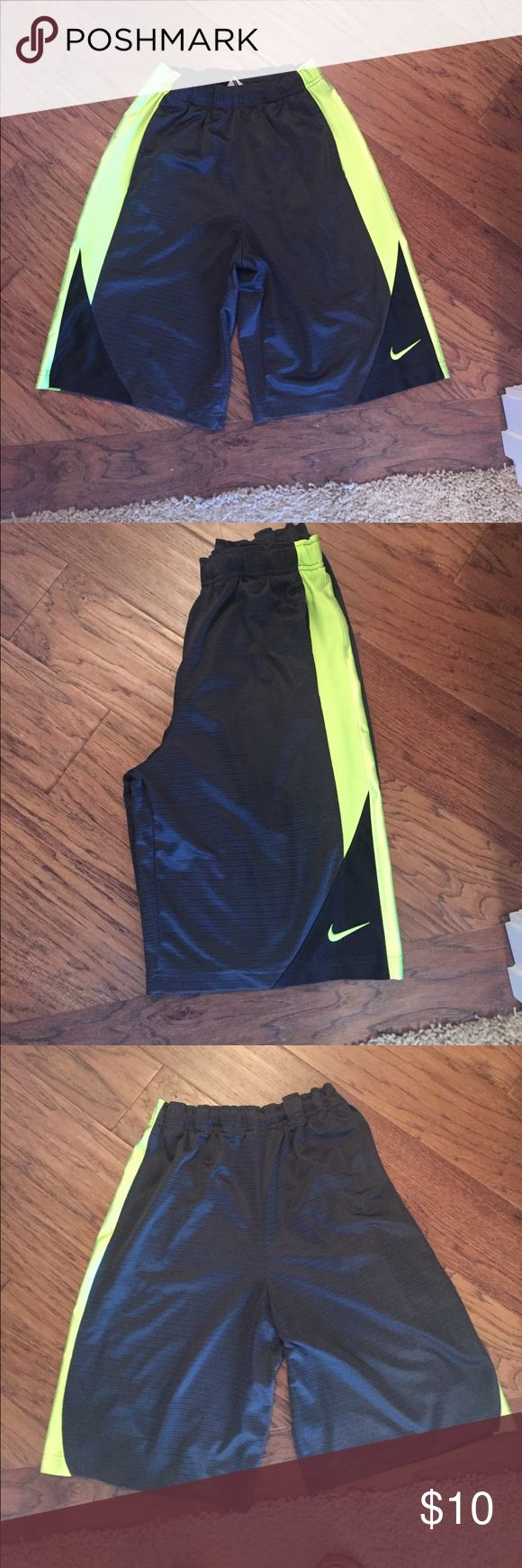 Nike Athletic shorts.  Kids Large Kids Large.  Nike athletic shorts.   Dark Gray with fluorescent accent.  Two pockets. Nike Bottoms Shorts