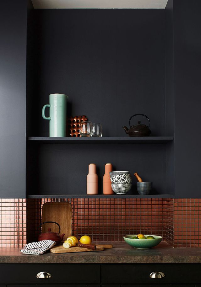 Brushed copper mosaic tiling and matt black walls with recessed shelving in this kitchen space-great ideas for kitchen decor.