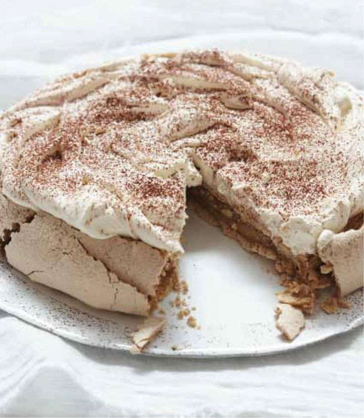 Cappuccino Pavlova from Nigella Lawson's Nigellissima cookbook. A stunning dessert recipe with coffee, cream and meringue. http://thehappyfoodie.co.uk/recipes/cappuccino-pavlova