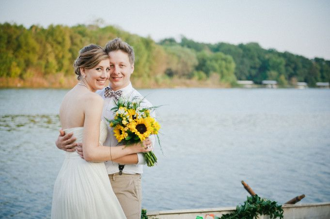 Bride and groom embrace lakeside with sunflower bouquet by @raemarshall | Two Bright Lights :: Blog
