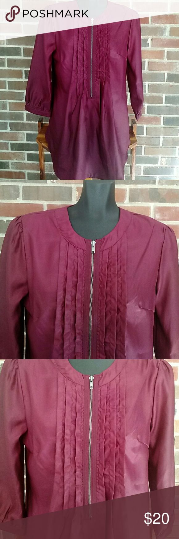 "LEL zipper tunic ""long elegant legs"" Size m, lightly loved, great tunic length, fully working front zipper, 3/4 sleeves. This top is designed for tall women, but works great as a longer tunic/dress on shorter. Maroon in color. Long Elegant Legs Tops Blouses"