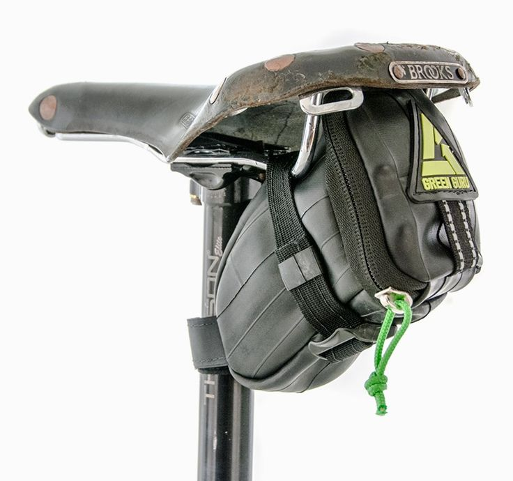 The Clutch upcycled bicycle inner tube saddle bag is similar to the larger Shifter, but is smaller and lighter. This bag fits snugly under your bike seat and can hold an extra tube, tools and repair kit. It secures into place with a wrap-around strap offering a stable storage solution when you're on the road.