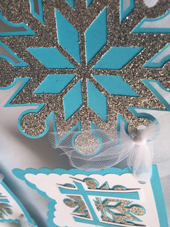 This beautiful banner is inspired by the movie Frozen. Everyone has Frozen fever, so lets add this Frozen birthday banner to your next event.  This frozen birthday banner is made from white, teal, and silver glitter card stock paper and strung together with white tulle. Each pennant is roughly 5 inches in height. Happy is roughly 30 inches in height and Birthday is roughly 32 inches in length. Add a name banner for a discount! Click the link below! Add it to your cart w/ this name banner...