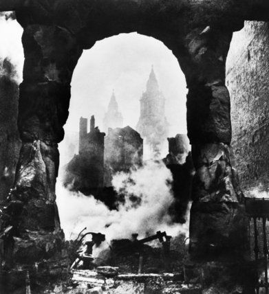 The western bell towers of St Paul's Cathedral in London seen through an archway after the heavy incendiary raid of 29 December 1940.  Beaton, Cecil  © IWM (MH 2718)