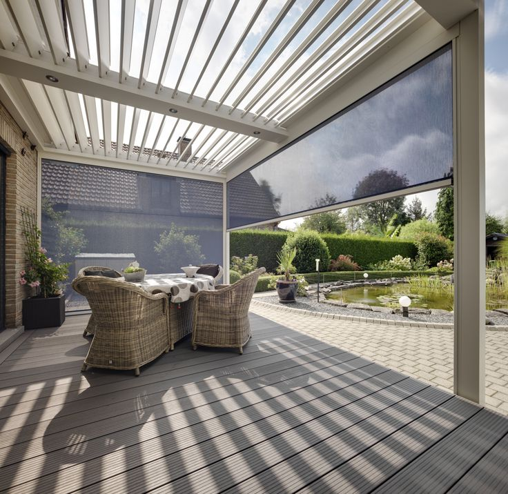 The Umbris Automated Outdoor Louvre Roof, is an all-weather patio roof system by IQ Glass that adjusts to filter sun and closes to shut out the rain.