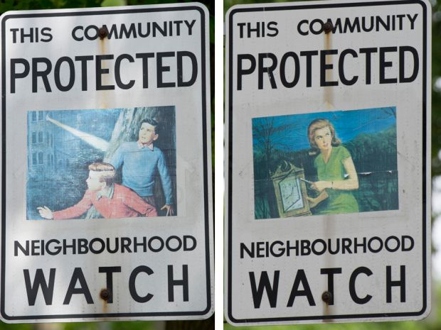 Neighbourhood watch signs in High Park have been plastered with  fictional characters, like the Hardy boys (left) and Nancy Drew.