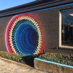 Street art in progress - Hoxxoh working on a new piece in Texas