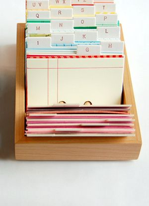 would love to try making one of these to use as an address book, so i could swap out the pages when they need updating - sharilyn of lovelydesign makes them with found paper, so sweet