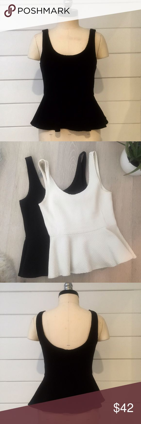 Anthropologie • black peplum top Super flattering Anthropologie - store brand, Ganni- peplum top. Heavy knit stretch cotton. In black and white. Sold separately. XS Anthropologie Tops