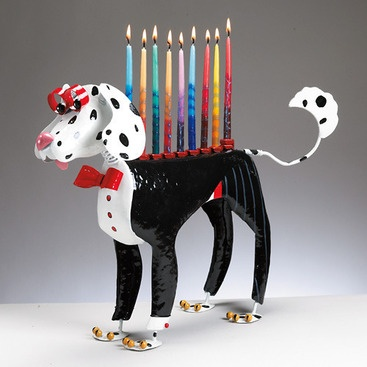 """Hand-crafted from star to finish. Every dog has his day, and this dog wants his day to be at your Chanukkah celebration. He (or she) is certainly well-dressed for the occasion (must not expect to go to any fire emergencies with the fire truck)! Sturdy and adorable.(15""""L x 4½""""W x 12½""""H)"""