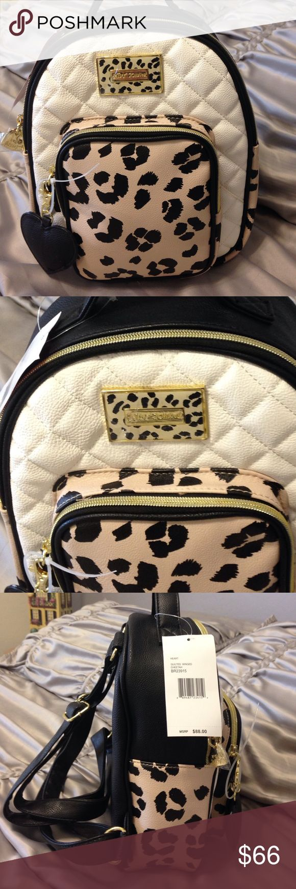 NEW -  Betsey Johnson Animal Print Backpack NEW -  Betsey Johnson Animal Print Backpack. This is super cute cream, black and tan. Gorgeous floral lining in this one! How can you not love Betsey? Bag measures 9 inches across, 11 inches high and 4 inches wide not counting additional front pocket. Betsey Johnson Bags Backpacks