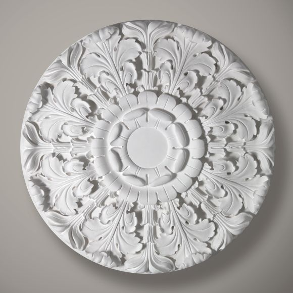 The Belmont is an exquisite Victorian style plaster ceiling rose.  This enchanting rose is handmade in 17 individual pieces.  Each component is cast from a face and back mould enabling heavily undercut enrichments and imposing detail.  Dimensions:-  Diameter:-920mm  The plain centre section:-150mm  Depth:-45mm