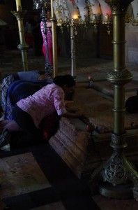 people praying inside the Church of the Holy Sepulchre in Jerusalem