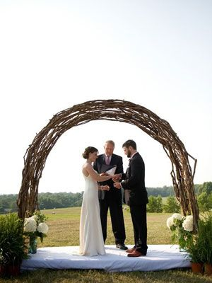 Love this arch made from natural materails to mark the ceremony spot.