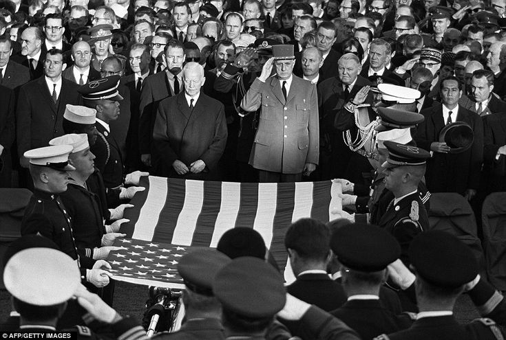Distinguished mourners: German President Heinrich Luebke, French President General Charles de Gaulle, Germany's Chancellor Ludwig Erhard and French Premier Maurice Couve de Murville (from left to right) pay respect to the flag-draped coffin of the late US President John Fitzgerald Kennedy in front of the Capitole in Washington