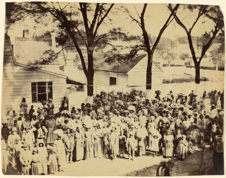 Among the first slaves to be liberated were those on J. J. Smith's cotton plantation near Beaufort, South Carolina, which had been occupied by the Union army since late 1861.   Newly freed men, women, and children are recorded at the historic moment as they assembled for their departure. Timothy O'Sullivan made this view of more than a hundred individuals standing in front of their former quarters, their meager belongings packed in burlap bundles as they begin their lives of freedom.