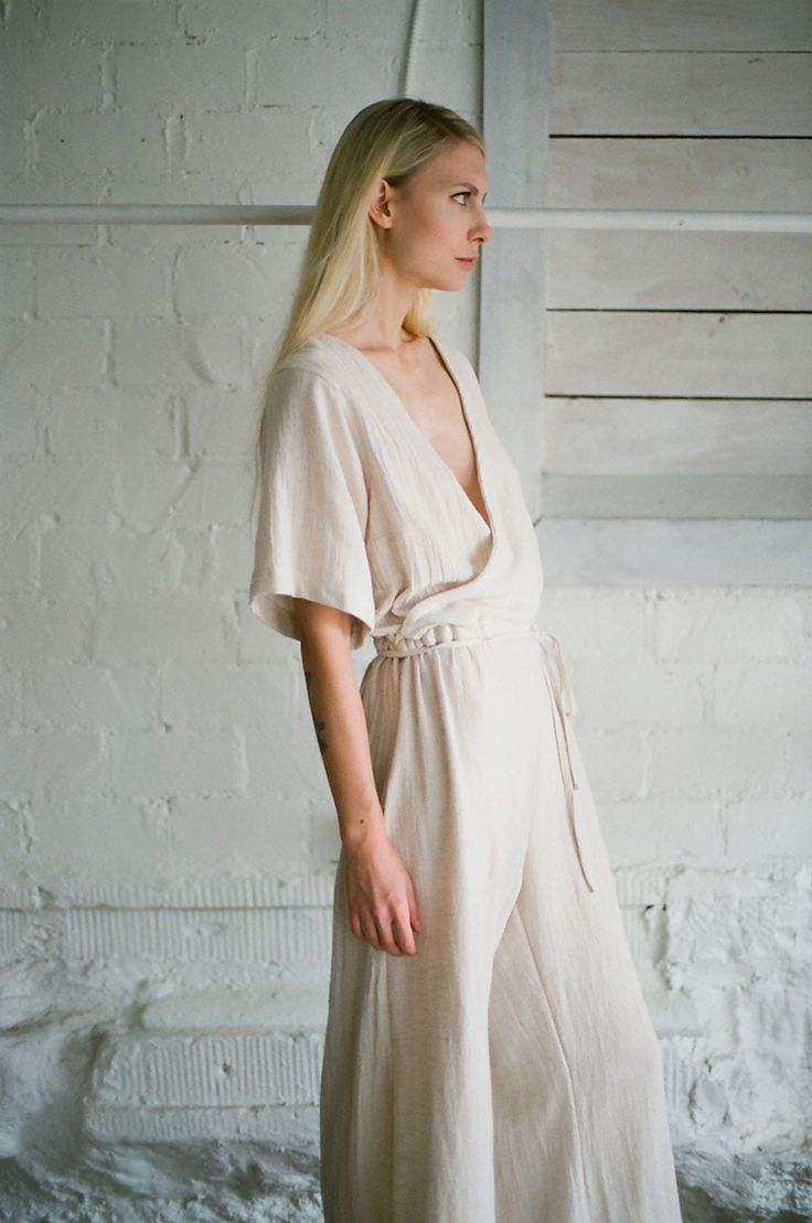 designed in austin + made in the USA // 100% cotton textured gauze // the beauty in this piece is it's endless versatility. this jumpsuit can be worn with the boat neck or v-neck in the front. the drawcord at waist also allows you to wear it relaxed or cinched - to define your waist.