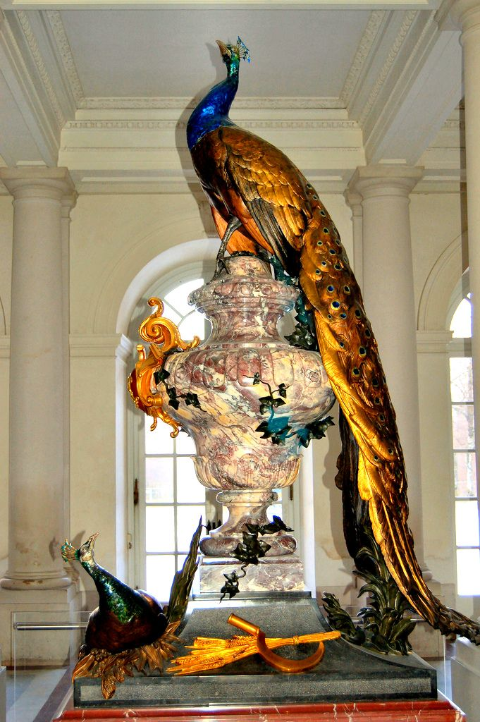 """Peacock statue at Herrenchiemsee Palace, Bavaria, Germany. (Building begun 1878 by King Ludwig II of Bavaria and unfinished at his death in 1886.) Richard Wagner wrote of Ludwig, """"Alas, he is so handsome and wise, soulful and lovely, that I fear that his life must melt away in this vulgar world like a fleeting dream of the gods."""""""