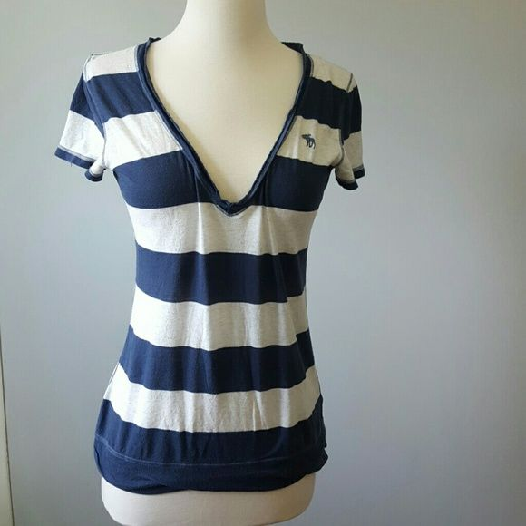 Abercrombie deep v tee Navy blue and white stripes. very deep v. Perfect for layering with a white cami Abercrombie & Fitch Tops Tees - Short Sleeve