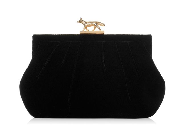 A gorgeous Lily Black evening clutch bag from Wilbur & Gussie. This bag has been beautifully designed with a black velvet fabric. Bag has a polished solid brass Fox clasp, optional gold chain and a inner pocket. View more bags from our Wilbur & Gussie Collection at: http://www.baroqueboutique.co.uk/wedding-shoes-and-accessories/
