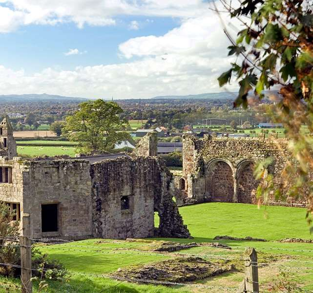 Haughmond Abbey The extensive remains of an Augustinian abbey, including its abbots' quarters, refectory and cloister. The substantially surviving chapter house has a frontage richly bedecked with 12th and 14th century carving and statuary, and a fine timber roof of around 1500.